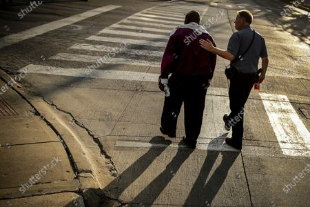 This photo from, shows Kansas City Police Chief Rick Smith, right, and Bishop Tony Caldwell, left, walking away for a private chat, during protests against police brutality in Kansas City, Mo., following the death of George Floyd in Minneapolis. The chaos unleashed in 2020, amid the coronavirus pandemic, has created space for different voices to speak, for different conversations to be had and for different questions to be asked