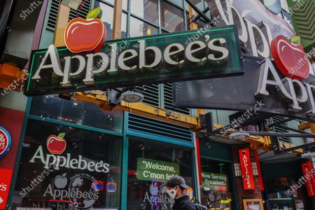 Applebee's logo is seen at one of their branches. Applebee's Neighbourhood Grill is expected to permanently shut down  15 branches during the fourth quarter, franchisor Dine Brands Global alerted investors Wednesday.