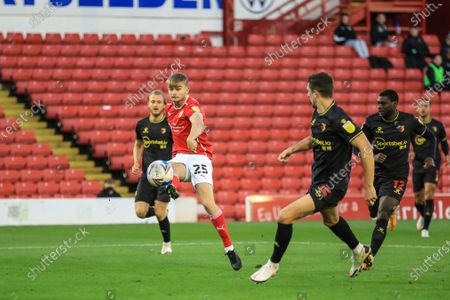Stock Picture of George Miller (25) of Barnsley shoots just wide