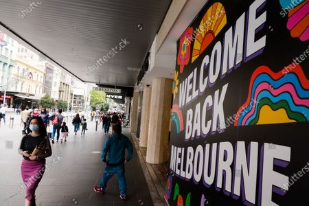 Stock Photo of A welcome back Melbourne sign is seen at the entrance of David Jones during COVID-19 in Melbourne, Australia. Melbourne enjoys its first weekend of relative freedom for months. Experts around the world have been warning against mandatory masks for health reasons, as well as their potential to influence a sense of overconfidence leading to the public to ignore social distancing. As Melbourne opens, its is becoming clear these warnings should have been considered by Premier Daniel Andrews.