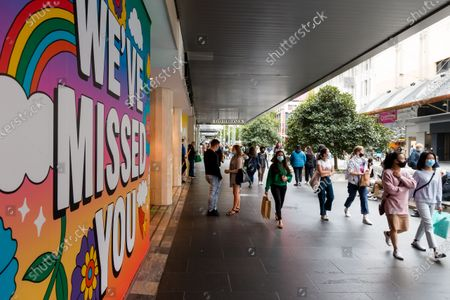 "A large ""We've Missed You"" sign is seen at David Jones during COVID-19 in Melbourne, Australia. Melbourne enjoys its first weekend of relative freedom for months. Experts around the world have been warning against mandatory masks for health reasons, as well as their potential to influence a sense of overconfidence leading to the public to ignore social distancing. As Melbourne opens, its is becoming clear these warnings should have been considered by Premier Daniel Andrews."