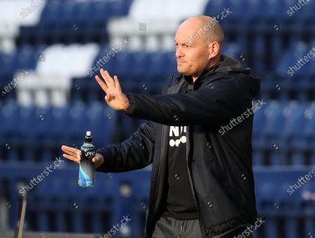 Preston North End manager Alex Neill signals to his players; Deepdale Stadium, Preston, Lancashire, England; English Football League Championship Football, Preston North End versus Birmingham City.