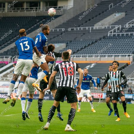 Dominic Calvert-Lewin of Everton climbing with Yerry Mina of Everton against Jamaal Lascelles of Newcastle United in the second half; St James Park, Newcastle, Tyne and Wear, England; English Premier League Football, Newcastle United versus Everton.