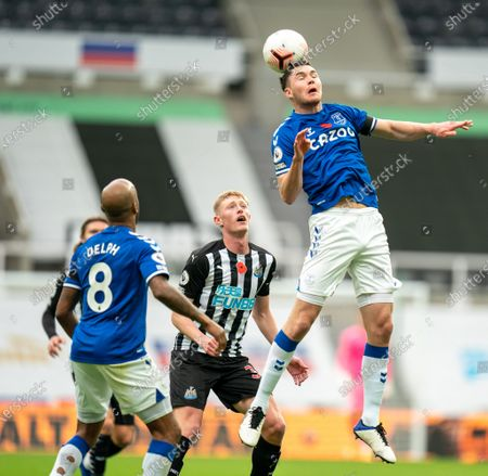 Michael Keane of Everton heads the ball on as Fabian Delph of Everton and Sean Longstaff of Newcastle United cover; St James Park, Newcastle, Tyne and Wear, England; English Premier League Football, Newcastle United versus Everton.