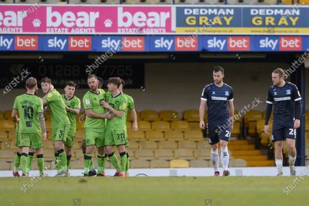 (R-L) Kyle Taylor and Harry Lennon of Southend react to Tom Pope of Port Vale celebrating his goal with teammates during Sky Bet League Two match between Southend and Port Vale at Roots Hall in Southend, UK - 31st October 2020