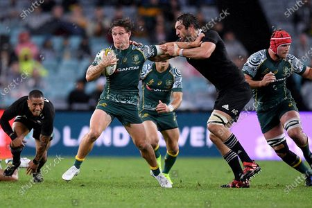Stock Image of Michael Hooper (L) of the Wallabies is tackled by Samuel Whitelock of the All Blacks (R) during the third Bledisloe Cup Rugby match between the New Zealand All Blacks and the Australian Wallabies at ANZ Stadium in Sydney, Australia, 31 October 2020.