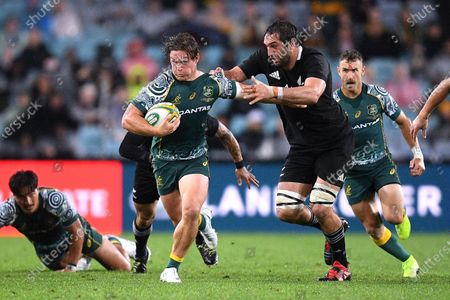 Stock Photo of Michael Hooper of the Wallabies is tackled by Samuel Whitelock of the All Blacks during the third Bledisloe Cup Rugby match between the New Zealand All Blacks and the Australian Wallabies at ANZ Stadium in Sydney, Australia, 31 October 2020.