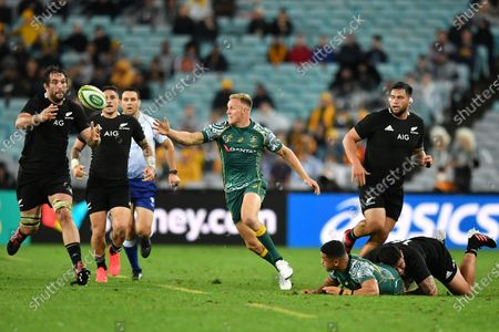 Samuel Whitelock (L) of the All Blacks takes up an off load from Hunter Paisami of the Wallabies during the third Bledisloe Cup Rugby match between the New Zealand All Blacks and the Australian Wallabies at ANZ Stadium in Sydney, Australia, 31 October 2020.