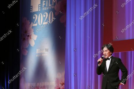 Japanese actor Koji Yakusho delivers a speech during the opening ceremony of the Tokyo International Film Festival in Tokyo