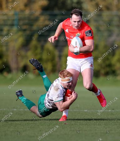 Munster's Sean French is tackled by Gavin Mullin of Ireland