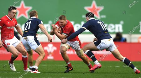 James Davies of Wales is tackled by Blair Kinghorn of Scotland.