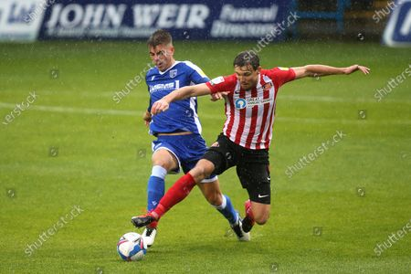 Jack Tucker of Gillingham and Sunderland's Charlie Wyke challenge for the ball