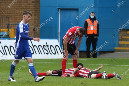 Lynden Gooch scores Sunderland's second goal and celebrates on the ground with Luke O'Nien while Charlie Wyke looks over them