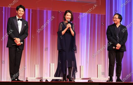 L) Japanese film director Koji Fukada, actress Mariko Tsutsui and Myanmarese actor Morisaki Win attend the opening ceremony of the Tokyo International Film Festival (TIFF) in Tokyo on Saturday, October 31, 2020. The TIFF will be held from October 31 through November 9.