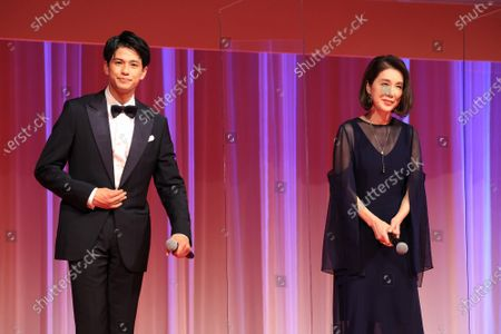 Japanese actress Mariko Tsutsui (R) and Myanmarese actor Morisaki Win attend the opening ceremony of the Tokyo International Film Festival (TIFF) in Tokyo on Saturday, October 31, 2020. The TIFF will be held from October 31 through November 9.