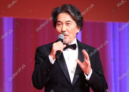 Japanese actor Koji Yakusho as the ambassador of the Tokyo International Film Festival (TIFF) delivers a speech at the opening ceremony of the TIFF which will be held from October 31 through November 9 in Tokyo on Saturday, October 31, 2020. Yakusho recently won the best actor award of the Chicago International Film Festival.