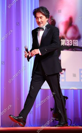 Japanese actor Koji Yakusho arrives at the opening ceremony for the Tokyo International Film Festival (TIFF) as the festival ambassador in Tokyo on Saturday, October 31, 2020. Yakusho recently won the best actor award of the Chicago International Film Festival.