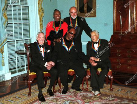 Group shot of the 1999 Kennedy Center Honorees at the State Department in Washington, D.C.. Left to Right: Jason Robards, Judith Jamison, Stevie Wonder, Sean Connery and Victor Borge..