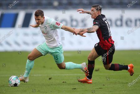 Maximilian Eggestein (L) of Werder Bremen  battles for possession with Steven Zuber of Eintracht Frankfurt during the German Bundesliga match between Eintracht Frankfurt and SV Werder Bremen at Deutsche Bank Park in Frankfurt am Main, Germany, 31 October 2020.