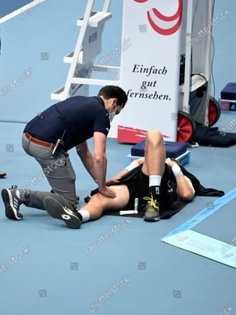 Medical staff helps Kevin Anderson of South Africa during his semi final match against Andrey Rublev of Russia at the Erste Bank Open ATP tennis tournament in Vienna, Austria, 31 October 2020.