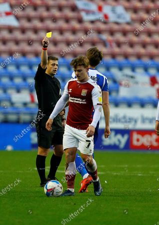 Wigan Athletic defender Tom Pearce (3) is booked during the EFL Sky Bet League 1 match between Wigan Athletic and Northampton Town at the DW Stadium, Wigan