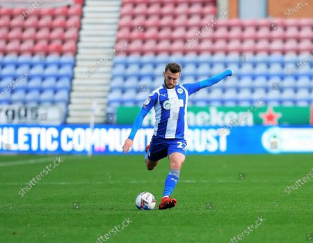 Wigan Athletic defender Tom James (27) crosses the ball  during the EFL Sky Bet League 1 match between Wigan Athletic and Northampton Town at the DW Stadium, Wigan