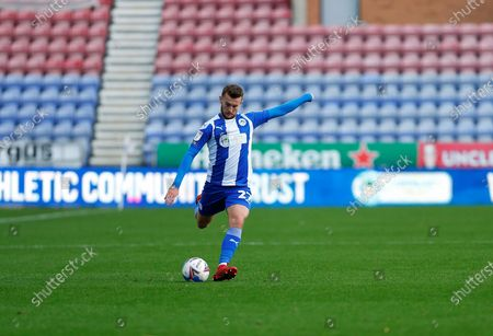 Stock Photo of Wigan Athletic defender Tom James (27) crosses the ball  during the EFL Sky Bet League 1 match between Wigan Athletic and Northampton Town at the DW Stadium, Wigan