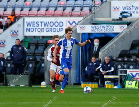 Wigan Athletic defender Tom Pearce (3) brings the ball forward during the EFL Sky Bet League 1 match between Wigan Athletic and Northampton Town at the DW Stadium, Wigan