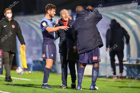 Wycombe Wanderers Assistant Richard Dobson celebrates at full time with Wycombe Wanderers defender Joe Jacobson (3) and Wycombe Wanderers forward Adebayo Akinfenwa (20) during the EFL Sky Bet Championship match between Wycombe Wanderers and Sheffield Wednesday at Adams Park, High Wycombe