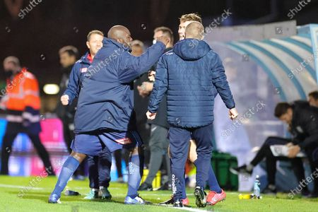 Wycombe Wanderers forward Adebayo Akinfenwa (20) celebrates at full time with goalscorer Wycombe Wanderers midfielder David Wheeler (7) during the EFL Sky Bet Championship match between Wycombe Wanderers and Sheffield Wednesday at Adams Park, High Wycombe
