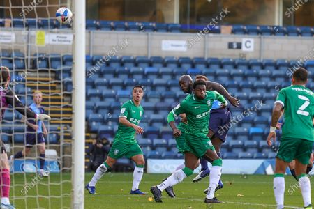 Wycombe Wanderers forward Adebayo Akinfenwa (20) heads towards goal during the EFL Sky Bet Championship match between Wycombe Wanderers and Sheffield Wednesday at Adams Park, High Wycombe