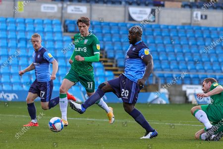 Wycombe Wanderers forward Adebayo Akinfenwa (20) shoots towards the goal during the EFL Sky Bet Championship match between Wycombe Wanderers and Sheffield Wednesday at Adams Park, High Wycombe