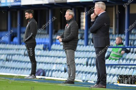 Charlton Athletic Manager Lee Bowyer flanked by Portsmouth Manager Kenny Jackett (right) and Charlton Athletic Assistant Manager Johnnie Jackson (left) during the EFL Sky Bet League 1 match between Portsmouth and Charlton Athletic at Fratton Park, Portsmouth