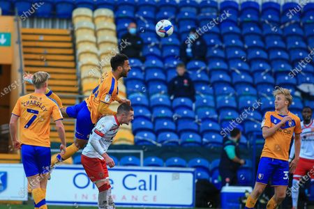 James Perch of Mansfield Town (14) heads the ball during the EFL Sky Bet League 2 match between Mansfield Town and Walsall at the One Call Stadium, Mansfield