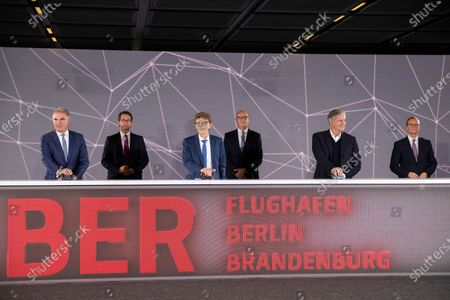 CEO of German airline Lufthansa Carsten Spohr (L-R), German Transport Minister Andreas Scheuer, CEO of the Berlin Brandenburg Airport 'BER' Engelbert Luetke-Daldrup, Brandenburg's State premier Dietmar Woidke, Low-cost airline EasyJet CEO Johan Lundgren and Berlin's Mayor Mueller press the button of start on the first day of operation for the new BER Berlin Brandenburg Airport on October 31, 2020 in Schoenefeld, Germany. The new airport incorporates former Schoenefeld airport as its Terminal 5 and also replaces Tegel Airport, which will close in coming days. Berlin Brandenburg Airport was originally scheduled to open in 2011 but was stricken by design flaws, corruption scandals, legal wranglings and failed technical audits. The airport will serve Berlin and the surrounding region.