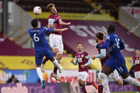 Chelsea's Thiago Silva, left jumps for the ball Burnley's Chris Wood during an English Premier League soccer match between Burnley and Chelsea at the Turf Moor stadium in Burnley, England