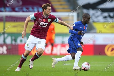 Chelsea's N'Golo Kante, right, vies for the ball with Burnley's Chris Wood during the English Premier League soccer match between Burnley and Chelsea at Turf Moor stadium in Burnley, England