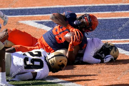 Stock Image of Illinois tight end Daniel Imatorbhebhe (88) falls into the end zone for a touchdown as Purdue cornerback Simeon Smiley, left, and DJ Johnson defend during the second half of an NCAA college football game, in Champaign, Ill