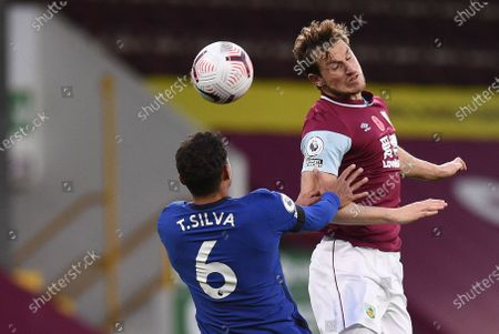 Chris Wood of Burnley (R) in action against Thiago Silva of Chelsea (L) during the English Premier League soccer match between Burnley FC and Chelsea FC in Burnley, Britain, 31 October 2020.