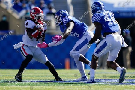 Georgia running back James Cook (4) is tackled by Kentucky linebacker DeAndre Square (5) during the second half of an NCAA college football game, in Lexington, Ky