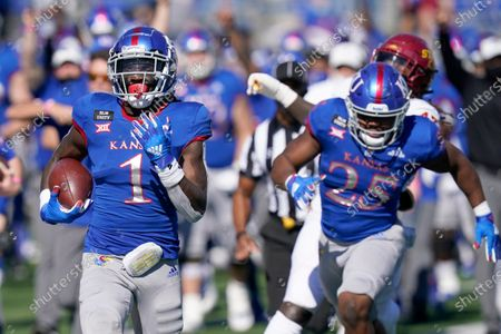 Stock Photo of Kansas return specialist Kenny Logan Jr. (1) returns a kickoff 100-yards for a touchdown during the second half of an NCAA college football game against Iowa State in Lawrence, Kan