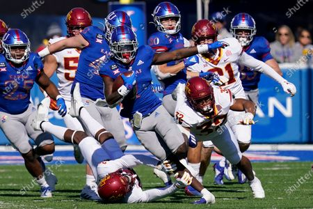 Kansas return specialist Kenny Logan Jr. (1) breaks away from Iowa State defenders Gerry Vaughn (32) and Vonzell Kelley III (29) for a 100-yard touchdown kickoff return during the second half of an NCAA college football game in Lawrence, Kan