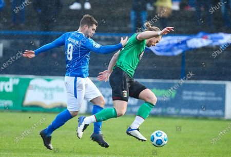 Coleraine vs Glentoran. Coleraine's James McLaughlin with Glentoran's Keith Cowan