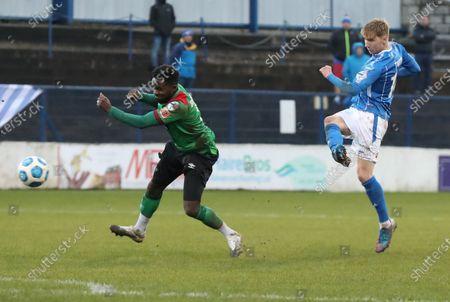 Stock Photo of Coleraine vs Glentoran. Coleraine's Evan Tweed and Glentora's Gael Bigirimana