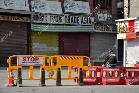 View of barricades set in front of closed shops during the shutdown in Kashmir. A shutdown was observed across the Kashmir valley to protest against India's new laws that allow Indians to buy land in the region. The shutdown call was made by a separatist group headed by Mirwaiz Umar Farooq.