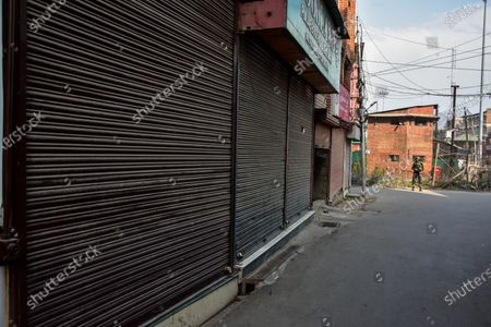 View of closed shops during the shutdown in Kashmir. A shutdown was observed across the Kashmir valley to protest against India's new laws that allow Indians to buy land in the region. The shutdown call was made by a separatist group headed by Mirwaiz Umar Farooq.