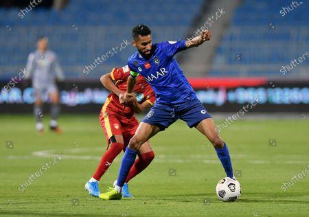 Al-Hilal's player Salman Al-Faraj (front) in action during the Saudi Professional League soccer match between Al-Hilal and Damac at Prince Faisal Bin Fahd Stadium in Riyadh, Saudi Arabia, 31 October 2020.