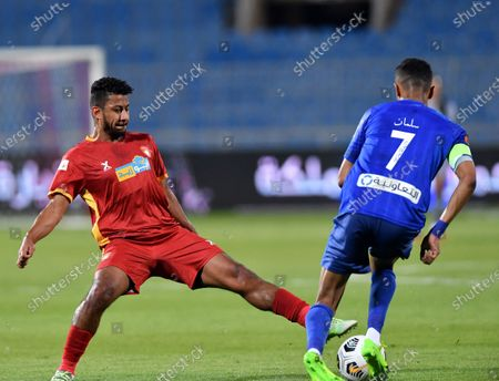 Al-Hilal's player Salman Al-Faraj (R) in action against Damac's Mohammed Attiyah (L) during the Saudi Professional League soccer match between Al-Hilal and Damac at Prince Faisal Bin Fahd Stadium in Riyadh, Saudi Arabia, 31 October 2020.