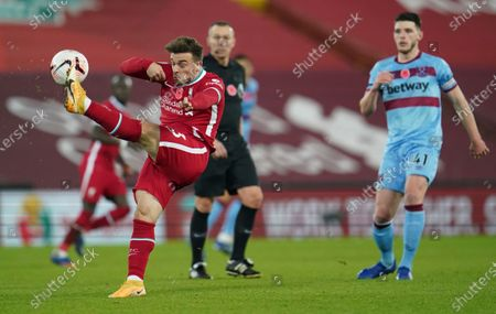 Liverpool's Xherdan Shaqiri clears the ball away during the English Premier League soccer match between Liverpool and West Ham United at Anfield stadium in Liverpool, England