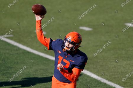 Illinois quarterback Matt Robinson passes during the first half of an NCAA college football game against Purdue, in Champaign, Ill